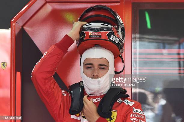 Ferrari's Monegasque driver Charles Leclerc gets ready for the third practice session at the Circuit Paul Ricard in Le Castellet, southern France, on...