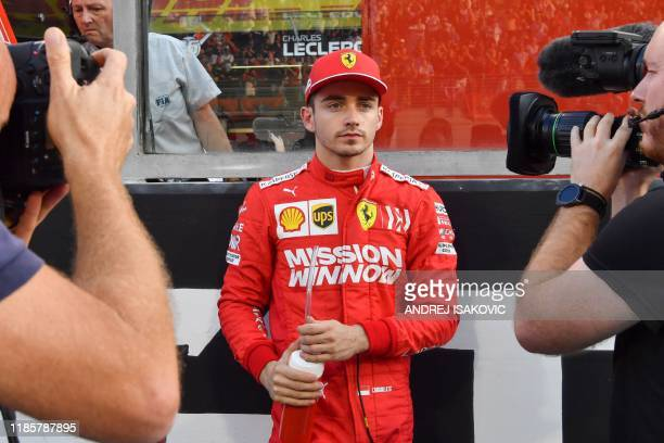 Ferrari's Monegasque driver Charles Leclerc is pictured on the grid at the Yas Marina Circuit in Abu Dhabi ahead of the final race of the Formula One...