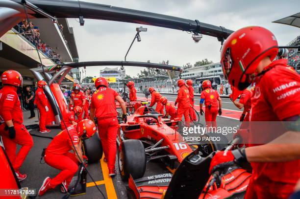 Ferrari's Monegasque driver Charles Leclerc is seen in his car in the pits during the second practice session of the Formula One Mexican Grand Prix...