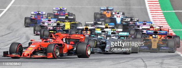 Ferrari's Monegasque driver Charles Leclerc leads at the start of the Austrian Formula One Grand Prix in Spielberg on June 30 2019