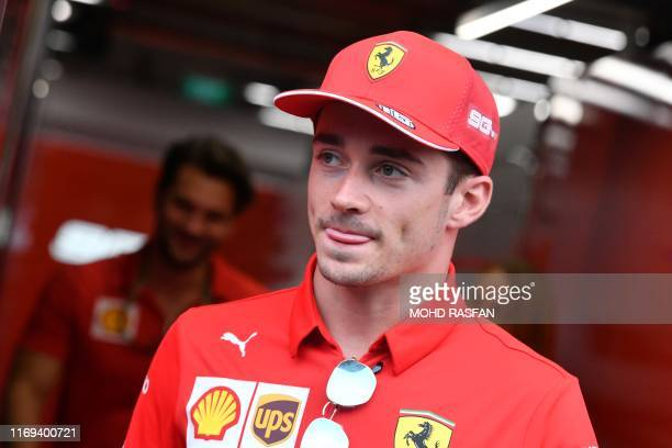 Ferraris Monegasque driver Charles Leclerc leaves his team garage ahead of the Formula One Singapore Grand Prix at the Marina Bay Street Circuit in...