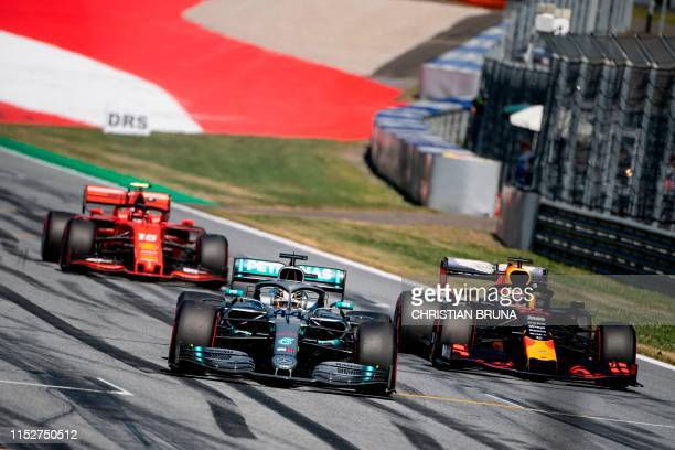 TOPSHOT Ferrari's Monegasque driver Charles Leclerc Mercedes' British driver Lewis Hamilton and Red Bull Racing's Dutch driver Max Verstappen during...