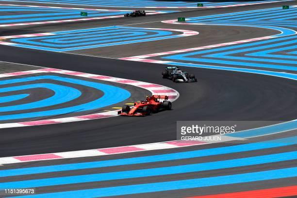 Ferrari's Monegasque driver Charles Leclerc Mercedes' drives ahead of British driver Lewis Hamilton and HAAS F1 Team's French driver Romain Grosjean...