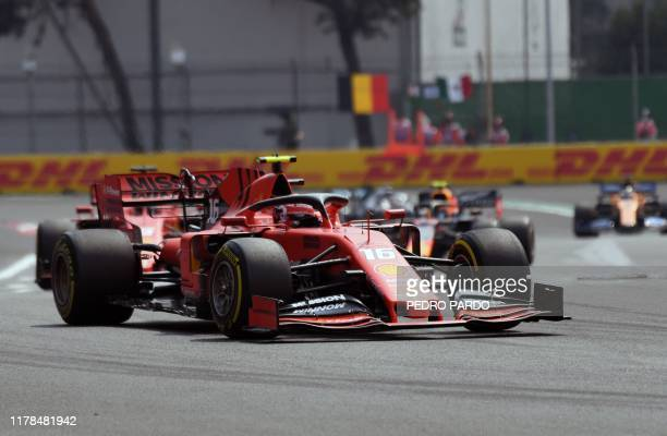 Ferrari's Monegasque driver Charles Leclerc power his car during the F1 Mexico Grand Prix, at the Hermanos Rodriguez racetrack in Mexico City on...