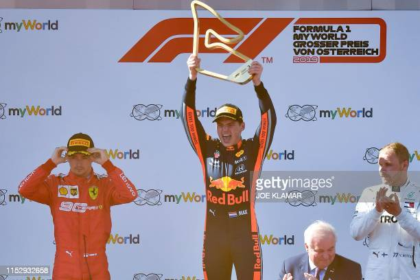 Ferrari's Monegasque driver Charles Leclerc, Red Bull Racing's Dutch driver Max Verstappen and Mercedes' Finnish driver Valtteri Bottas stand on the...