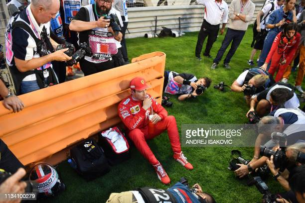 Ferrari's Monegasque driver Charles Leclerc rests prior to the Formula One Bahrain Grand Prix at the Sakhir circuit in the desert south of the...