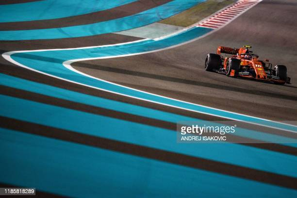 Ferrari's Monegasque driver Charles Leclerc steers his car at the Yas Marina Circuit in Abu Dhabi during the final race of the Formula One Grand Prix...