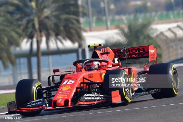 Ferrari's Monegasque driver Charles Leclerc steers his car during the third practice session at the Yas Marina Circuit in Abu Dhabi a day ahead of...