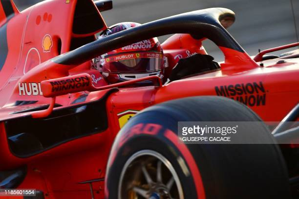 Ferrari's Monegasque driver Charles Leclerc steers his car during the qualifying session at the Yas Marina Circuit in Abu Dhabi a day ahead of the...