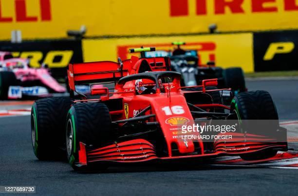 Ferrari's Monegasque driver Charles Leclerc steers his car during the Formula One Hungarian Grand Prix race at the Hungaroring circuit in Mogyorod...