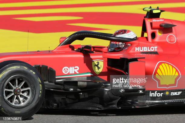 Ferrari's Monegasque driver Charles Leclerc steers his car during the Formula One Russian Grand Prix at the Sochi Autodrom Circuit in Sochi on...