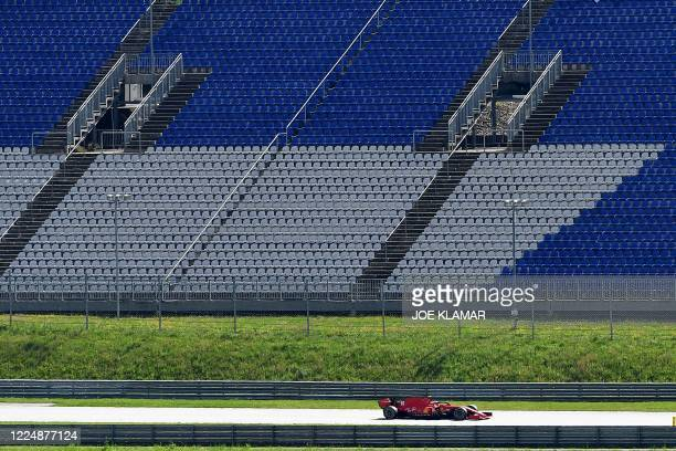 Ferrari's Monegasque driver Charles Leclerc steers his car in front of empty stands during the Austrian Formula One Grand Prix race on July 5 2020 in...