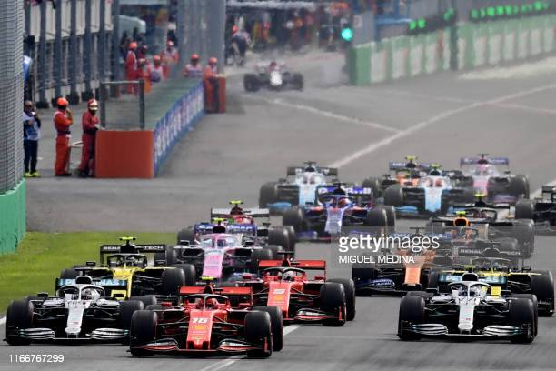 Ferrari's Monegasque driver Charles Leclerc takes the lead at the start of the Italian Formula One Grand Prix at the Autodromo Nazionale circuit in...