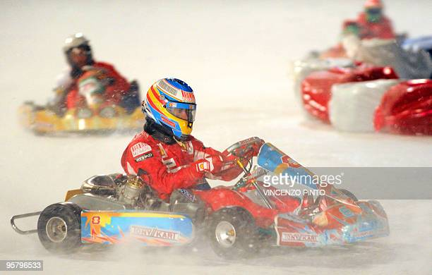 Ferrari's new driver Sapanish Fernando Alonso takes part in an ice kart race on January 15 2010 during the 'Wrooom 2010 F1 and MotoGP Press Ski...
