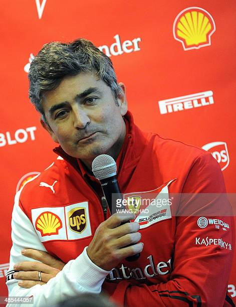 Ferrari's new team principal Marco Mattiachi talks to the media after the second practice session of the Formula One Chinese Grand Prix in Shanghai...