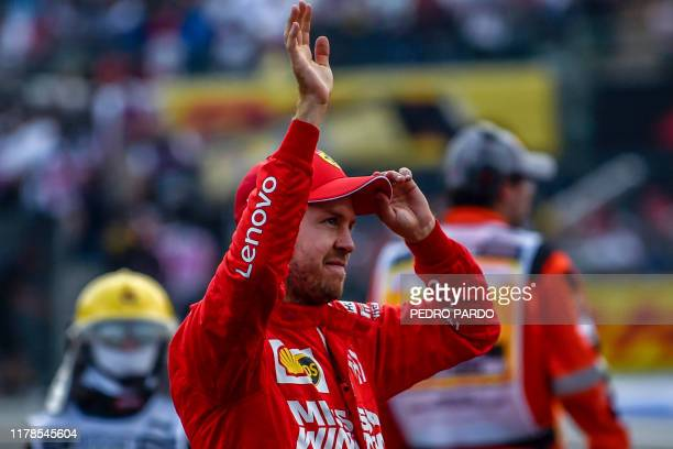 Ferrari's Sebastian Vettel celebrates after getting a second-place at the Hermanos Rodriguez racetrack in Mexico City on October 27, 2019. - Lewis...