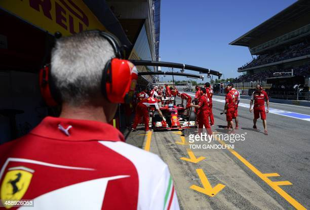 Ferrari's Spanish driver Fernando Alonso arrives in the pits during the second practice session at the Circuit de Catalunya, in Montmelo, on the...