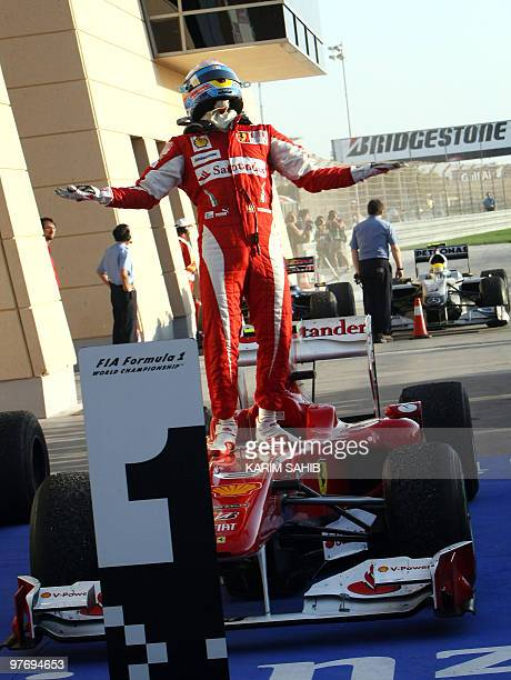 Ferrari's Spanish driver Fernando Alonso celebrates in the parc ferme of the Bahrain international circuit on March 14 2010 in Manama after the...
