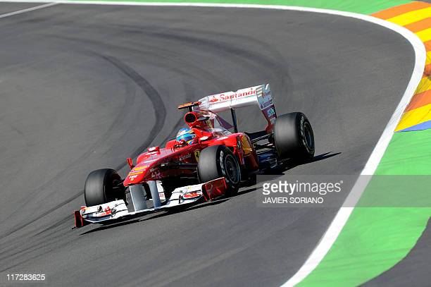 Ferrari's Spanish driver Fernando Alonso drives at the Valencia Street Circuit on June 25 2011 in Valencia during the third practice race of the...