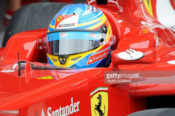Ferrari's Spanish driver Fernando Alonso enters the pits at the Valencia Street Circuit on June 24 2011 in Valencia during the second practice race...