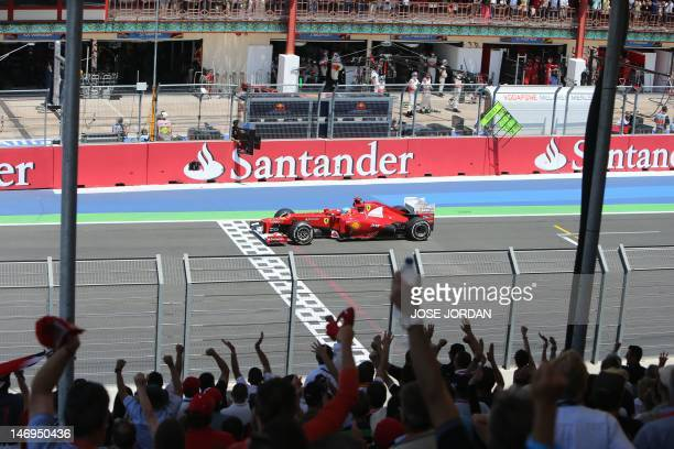 Ferrari's Spanish driver Fernando Alonso leads at the Valencia Street Circuit on June 24, 2012 in Valencia during the European Formula One Grand...