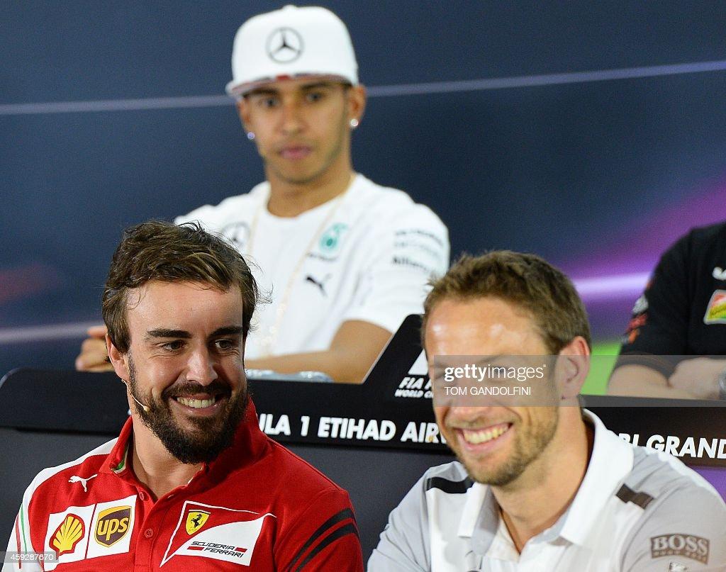 Ferrari's Spanish driver Fernando Alonso, Mercedes-AMG's British driver Lewis Hamilton and McLaren Mercedes' British driver Jenson Button sit during the press conference at the Yas Marina circuit in Abu Dhabi on November 20, 2014 ahead of the Abu Dhabi Formula One Grand Prix.