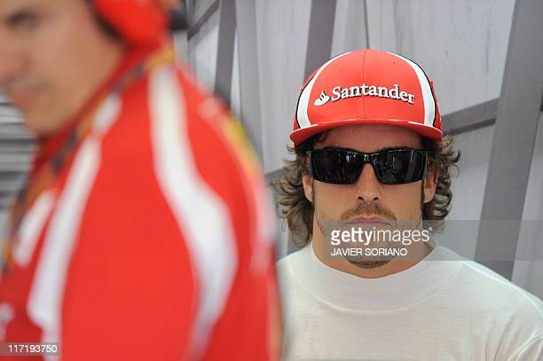 Ferrari's Spanish driver Fernando Alonso sits in the pits at the Valencia Street Circuit on June 24 2011 in Valencia during the second practice race...