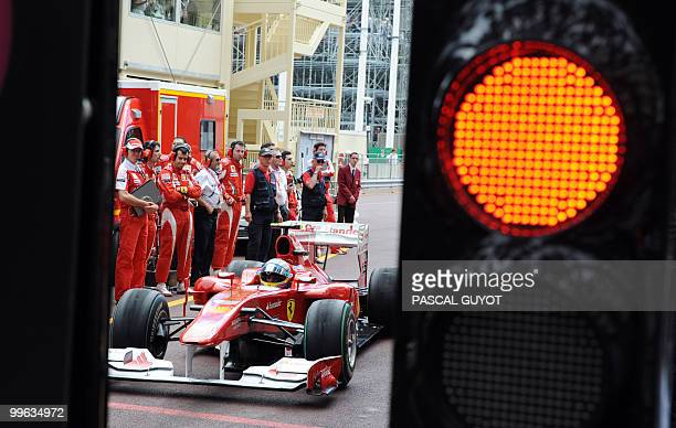Ferrari's Spanish driver Fernando Alonso waits for the start of the Monaco Formula One Grand Prix in the pits of the Monaco street circuit on May 16...