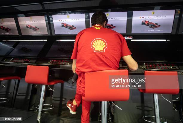 Ferrari's team engineer checks equipment at the Formula One Singapore Grand Prix at the Marina Bay Street Circuit in Singapore on September 19 2019