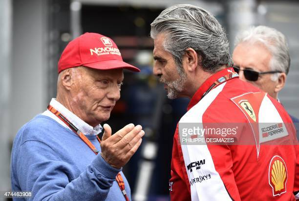 Ferrari's team Italian manager Maurizio Arrivabene speaks with Mercedes AMG Petronas F1 Team's Austria director Niki Lauda in the pits during the...