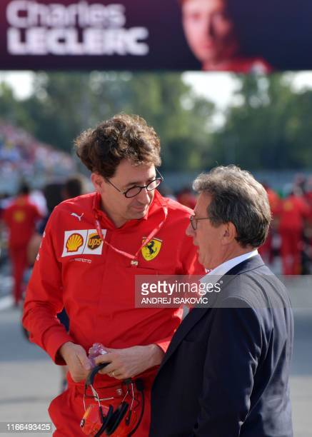 Ferrari's Team Principal Mattia Binotto speaks with Ferrari CEO Louis C. Camilleri after the qualifying session at the Autodromo Nazionale circuit in...