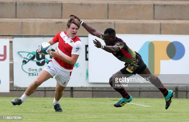 Ferrat Etienne of Maritius challenged by Ocen Levis of Uganda during the 2019 Rugby Africa Mens 7s match between Uganda and Mauritius at the Bosman...