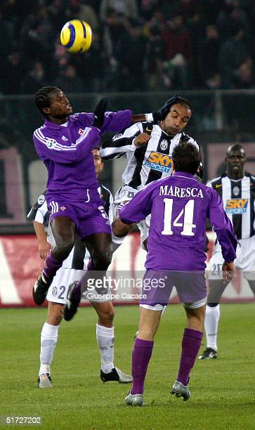 Ferreira Emerson of Juventus and Christian Obodo of Fiorentina fight for the ball during their Italian serie A football match on November 10, 2004 at...