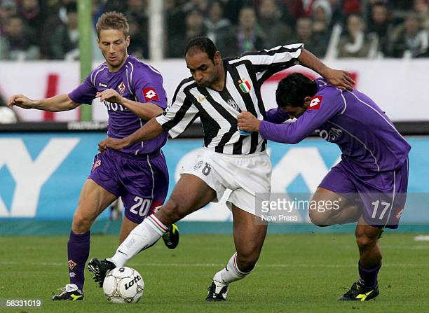 Ferreira Emerson of Juventus is challenged by Christian Maggio and Martin Jorgensen of Fiorentina during the Serie A match between Fiorentina and...