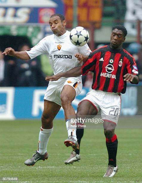Ferreira Emerson of Roma clashes with Clarence Seedorf of Milan during the Serie A match between Milan and Roma played at the San Siro stadium on May...