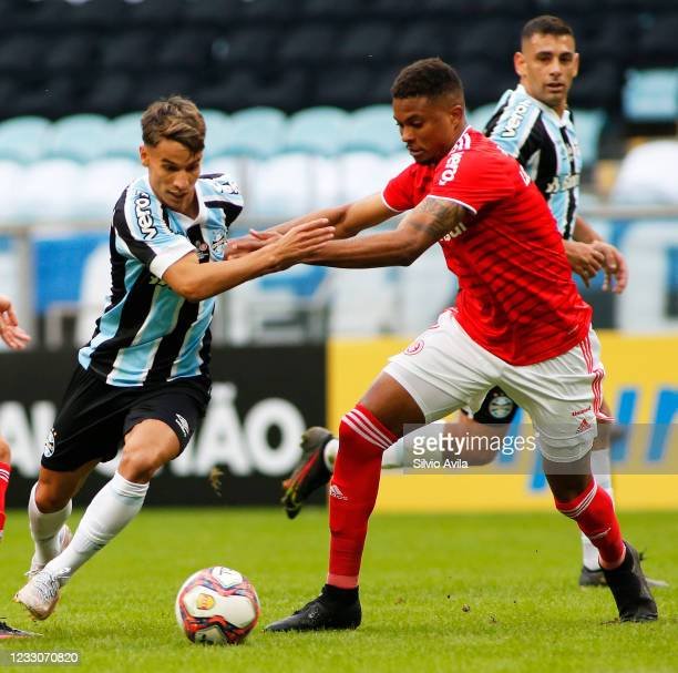 Ferreira of Gremio and Lucas Ribeiro of Internacional fight for the ball during the final of Rio Grande Do Sul State Championship 2021 between Gremio...