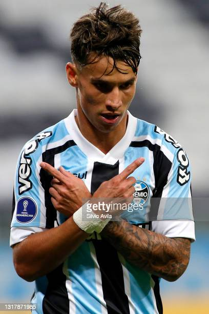 Ferreira of Gremio celebrates after scoring the third goal of his team during a match between Gremio and Lanus as part of group H of Copa CONMEBOL...