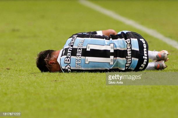 Ferreira of Gremio reacts after being injured during a match between Gremio and Lanus as part of group H of Copa CONMEBOL Sudamericana 2021 at Arena...