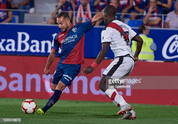 Ferreiro midfielder of SD Huesca competes for the ball with Advincula defender of Rayo Vallecano de Madrid during the La Liga game between SD Huesca...