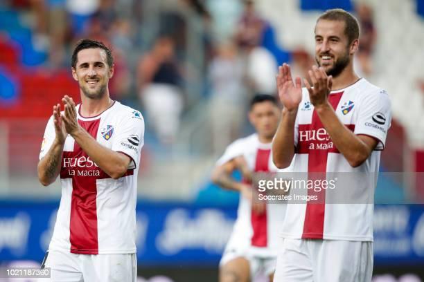 Ferreiro of SD Huesca Pulido of SD Huesca celebrates the victory during the La Liga Santander match between Eibar v SD Huesca at the Estadio...
