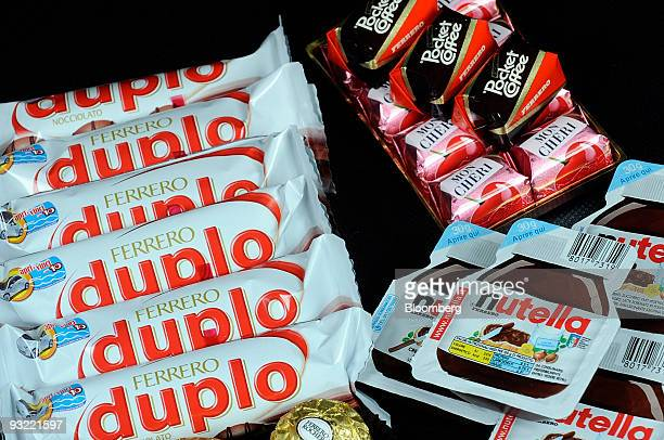 Ferrero SpA's Duplo Fererro Rocher Nutella and Pocket Coffee chocolate products are arranged for a photograph in Milan Italy on Thursday Nov 19 2009...