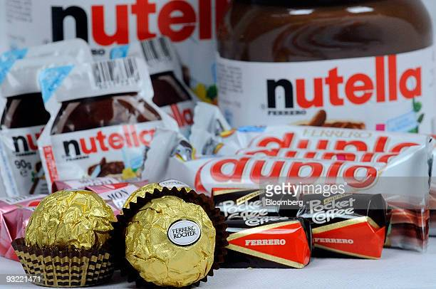 Ferrero SpA's Duplo Fererro Rocher Nutella Mon Cheri and Pocket Coffee chocolate products are arranged for a photograph in Milan Italy on Thursday...