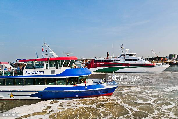 ferries at cuxhaven harbour - helgoland stock pictures, royalty-free photos & images
