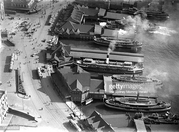 Ferries docked at the wharves of Circular Quay Sydney circa 1926