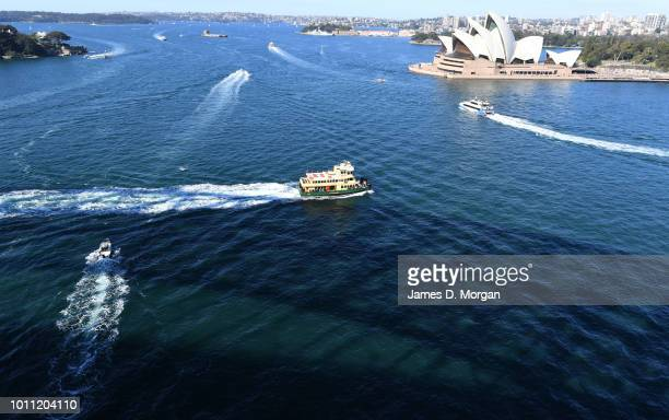 Ferries on the harbour with a shadow of the Harbour Bridge on the water on August 5 2018 in Sydney Australia Sydney has had 13 days of at least 20...
