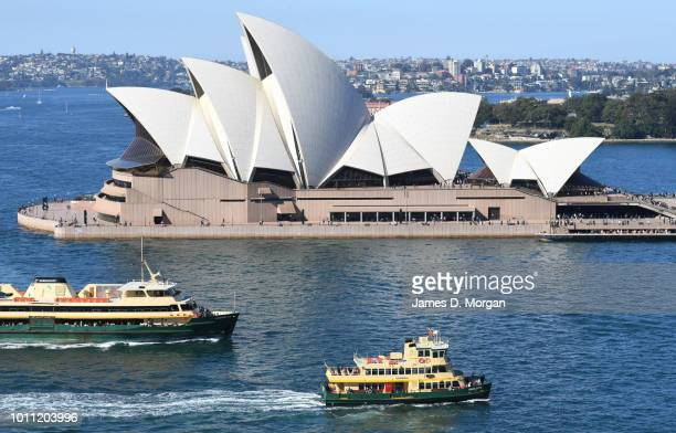 Ferries with passengers seated outside pass the Opera House in the warm winter sunshine on August 5 2018 in Sydney Australia Sydney has had 13 days...