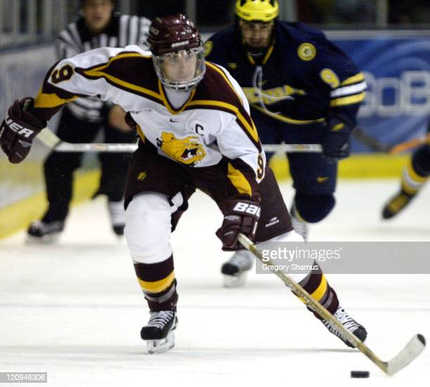 Ferris State forward Derrick Mciver races down the ice against Michigan during second period action at Yost Ice Arena in Ann Arbor Michigan on...