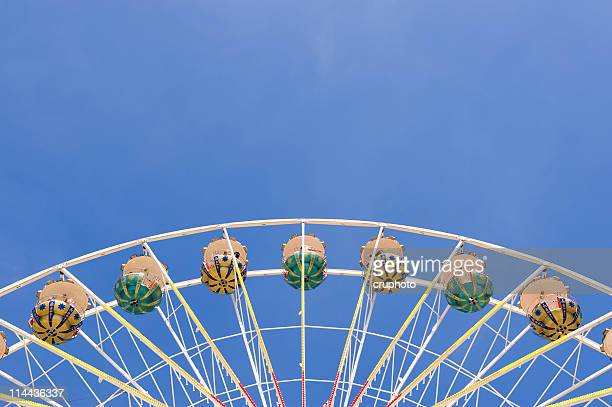 Ferris wheel against blue sky with copyspace at the top