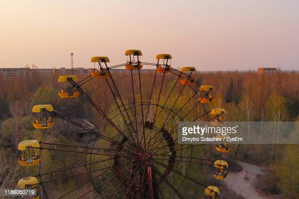 ferris wheel against sky during sunset - chernobyl stock pictures, royalty-free photos & images