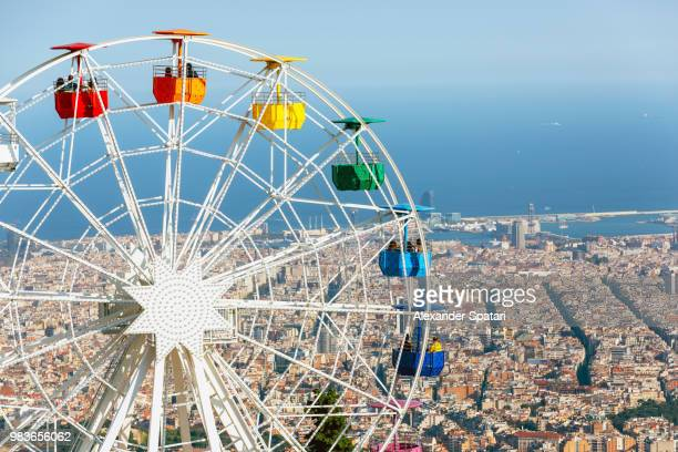 ferris wheel and barcelona skyline, catalonia, spain - tibidabo stock pictures, royalty-free photos & images